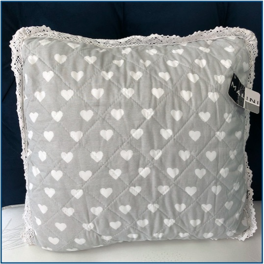 Grey cushion cover with white heart pattern and lace edge
