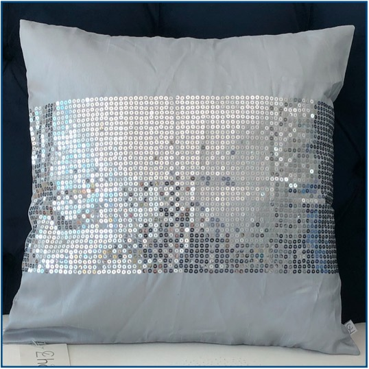 Grey cushion cover with thick stripe of sequins