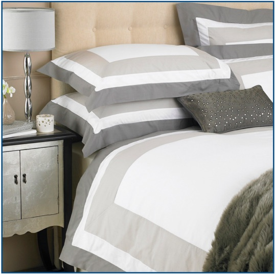 White cotton duvet set with taupe double border